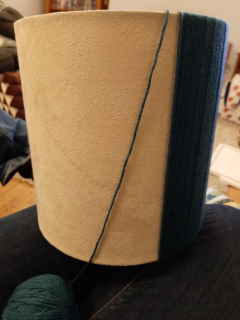 winding wool around a lampshade