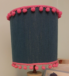 upcycled lampshade with teal wool and pink pom pom braid