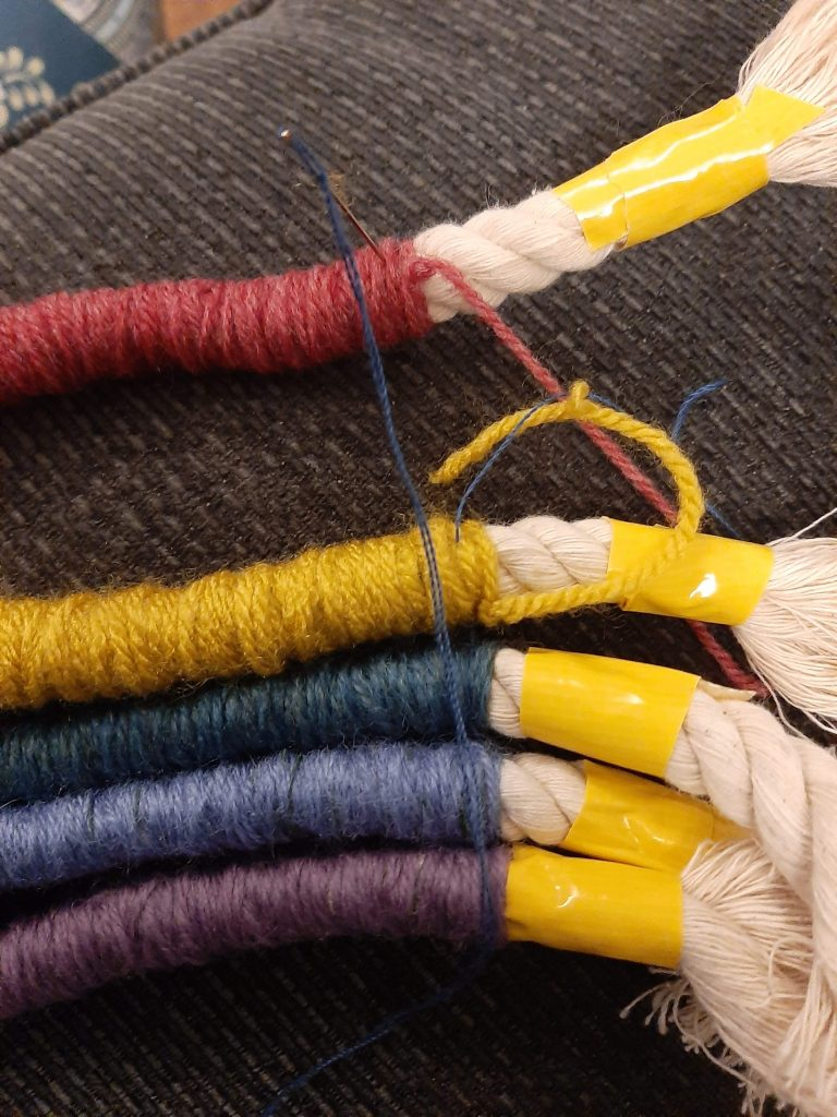 sewing together the rope rainbow