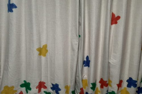 meeple curtains with yellow, red, green and blue meeples